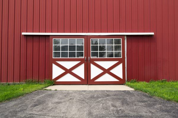 double red barn steel door in the coutryside