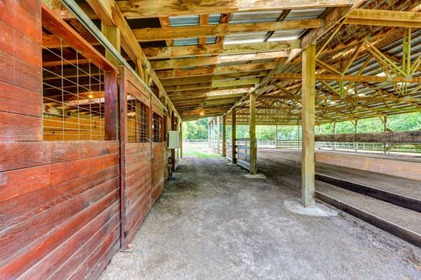 Empty wooden building with stables in the countryside. Northwest, USA